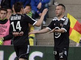 Lorient's French midfielder Romain Philippoteaux and Lorient's French Portuguese defender Raphael Guerreiro celebrates after scoring a goal during the French L1 football match between Nantes and Lorient on May 16, 2015