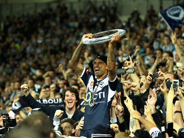 Archie Thompson of Melbourne thanks fans after a win during the 2015 A-League Grand Final match between the Melbourne Victory and Sydney FC at AAMI Park on May 17, 2015