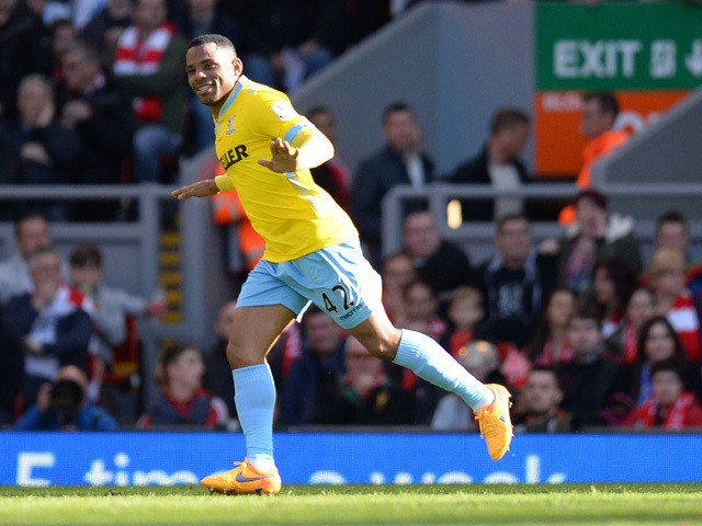 Crystal Palace's English midfielder Jason Puncheon celebrates scoring the 1-1 equalising goal from a free kick during the English Premier League football match between Liverpool and Crystal Palace at the Anfield stadium in Liverpool, northwest England, on