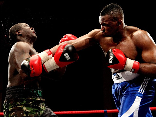 Dillian Whyte connects with Hastings Rassani during their Heavyweight bout at Liverpool Olympia on January 21, 2012
