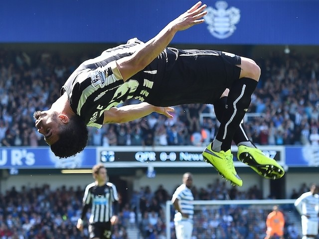 Newcastle United's French striker Emmanuel Riviere celebrates after scoring the opening goal during the English Premier League football match between Queens Park Rangers and Newcastle United at Loftus Road in London on May 16, 2015