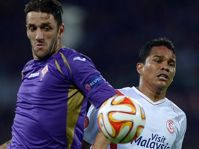 Fiorentina's Argentinian defender Gonzalo Rodriguez (L) vies for the ball with Sevilla's Colombian forward Carlos Bacca during the UEFA Europa League second leg semi-final football match Fiorentina vs Sevilla at the Artemio Franchi Stadium in Florence on