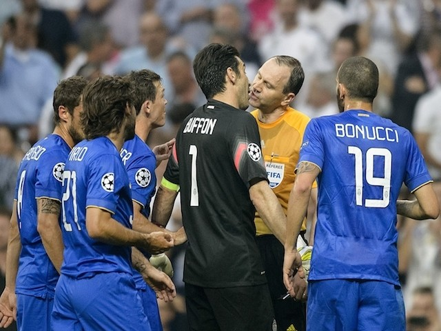 Juventus' goalkeeper and captain Gianluigi Buffon (C) argues with the referee during the UEFA Champions League semifinal second leg football match Real Madrid FC vs Juventus at the Santiago Bernabeu stadium in Madrid on May 13, 2015