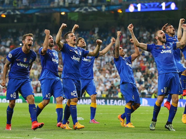 Juventus players celebrate following their progression to the final during the UEFA Champions League Semi Final, second leg match between Real Madrid and Juventus at Estadio Santiago Bernabeu on May 13, 2015