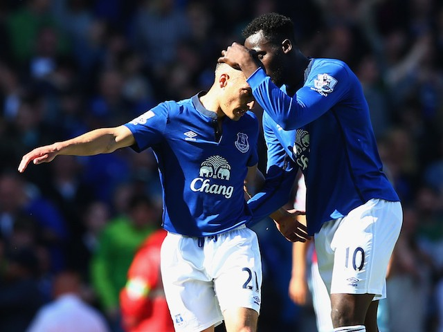 Leon Osman of Everton is congratulated by Romelu Lukaku of Everton on scoring their first goal during the Barclays Premier League match between West Ham United and Everton at Boleyn Ground on May 16, 2015