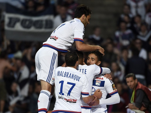 Lyon's French forward Nabil Fekir is congratuled by teamates after scoring during the French L1 football match Olympique Lyonnais against FC Girondins de Bordeaux on May 16, 2015