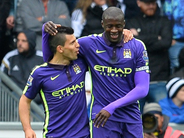 Manchester City's Ivorian midfielder Yaya Toure celebrates scoring the opening goal with Manchester City's Argentinian striker Sergio Aguero during the English Premier League football match between Swansea City and Manchester City at The Liberty Stadium i