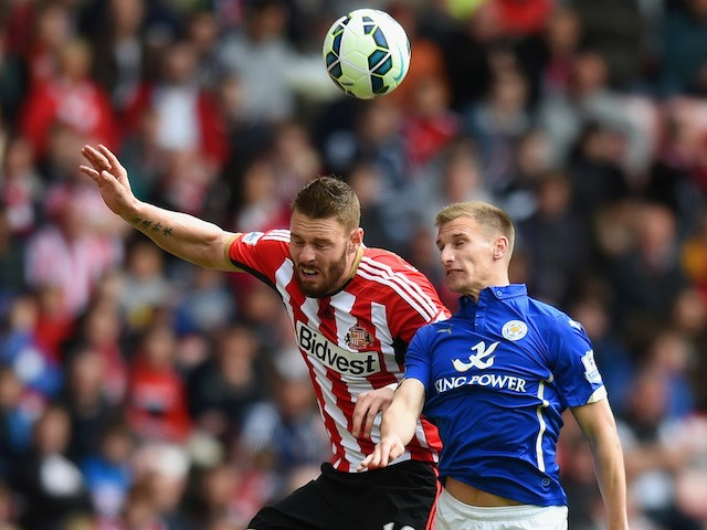 Connor Wickham of Sunderland and Marc Albrighton of Leicester City compete for the ball during the Barclays Premier League match between Sunderland and Leicester City at Stadium of Light on May 16, 2015