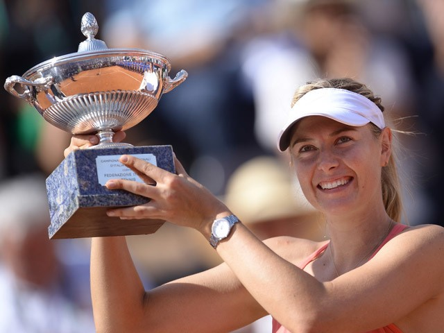 Maria Sharapova of Russia holds her trophy after winning the women's final match against Carla Suarez Navarro of Spain during at the WTA Tennis Open on May 17, 2015
