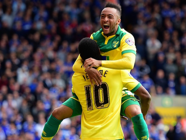 Cameron Jerome of Norwich City (10) celebrates with team mate Nathan Redmond as he scores their third goal during the Sky Bet Championship Playoff semi final second leg match between Norwich City and Ipswich Town at Carrow Road on May 16, 2015