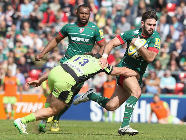 Niall Morris of Leicester is held by Dom Waldouck during the Aviva Premiership match between Leicester Tigers and Northampton Saints at Welford Road on May 16, 2015