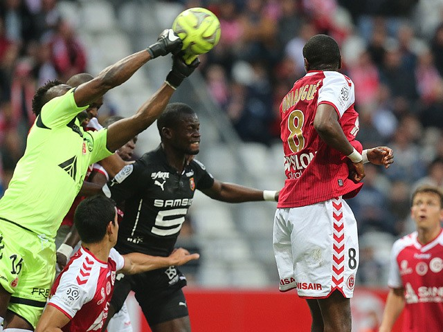 Reims' Togolese goalkeeper Kossi Agassa catches the ball in front of Rennes' Senegalese defender Fallou Diagne during the L1 match Reims and Rennes on May 16, 2015