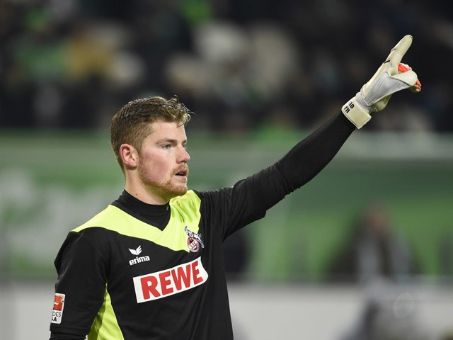 Timo Horn raises his hand during the German first division Bundesliga football match VfL Wolfsburg vs 1 FC Koln at the Volkswagen Arena in Wolfsburg, central Germany on December 20, 2014