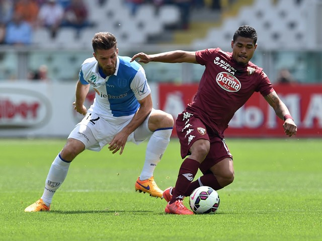 Josef Alexander Martinez of Torino FC in action against Bostjan Cesar of AC Chievo Verona during the Serie A match between Torino FC and AC Chievo Verona at Stadio Olimpico di Torino on May 17, 2015