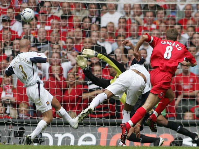 Liverpool's Steven Gerrard (R) puts the ball past West Ham goalkeeper Shaka Hislop to score his team's secong goal during the FA Cup final at the Millennium Stadium in Cardiff, 13 May 2006.