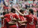 Bayern Munich's Polish striker Robert Lewandowski celebrates scoring with his team-mates during German first division Bundesliga football match FC Bayern Munich vs 1 FSV Mainz 05 at the Allianz Arena in Munich, southern Germany on May 23, 2015