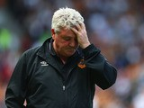 Steve Bruce manager of Hull City looks on during the Barclays Premier League match betwee