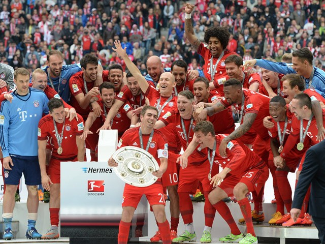 Bayern Munich's players celebrates wining their 25th Bundesliga title after German first division Bundesliga football match FC Bayern Munich vs 1 FSV Mainz 05 at the Allianz Arena in Munich, southern Germany on May 23, 2015