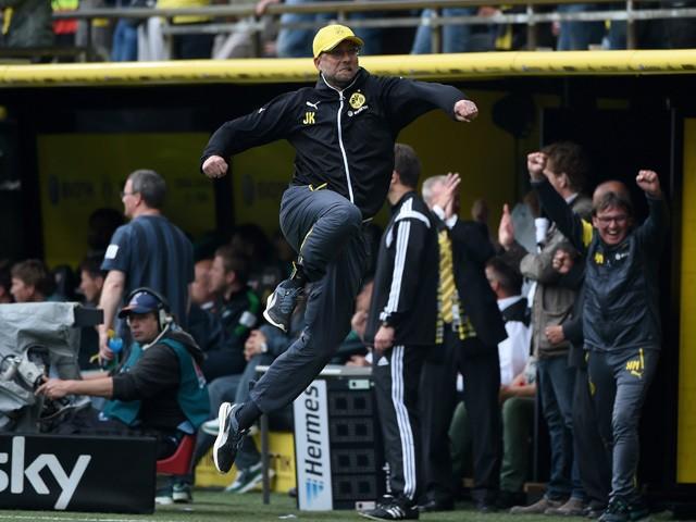 Dortmund's head coach Jurgen Klopp celebrates during German first division Bundesliga football match between Borussia Dortmund and SV Werder Bremen at the Signal Iduna Park in Dortmund, western Germany on May 23, 2015
