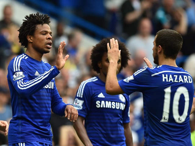 Chelsea's French striker Loic Remy celebrates with Chelsea's Belgian midfielder Eden Hazard (R) after scoring their third goal during the English Premier League football match between Chelsea and Sunderland at Stamford Bridge in London on May 24, 2015