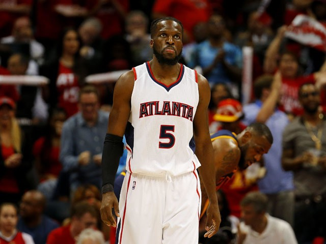 DeMarre Carroll #5 of the Atlanta Hawks reacts in the first quarter against the Cleveland Cavaliers during Game One of the Eastern Conference Finals of the 2015 NBA Playoffs at Philips Arena on May 20, 2015