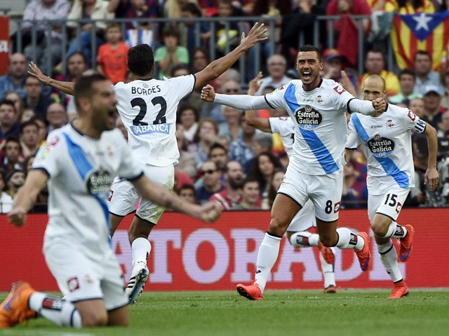 Deportivo's players celebrate a goal during the Spanish league football match FC Barcelona vs RC Deportivo La Coruna at the Camp Nou stadium in Barcelona on May 23, 2015