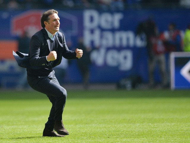 Hamburg's coach Bruno Labbadia celebrates the 2nd goal during German first division Bundesliga football match between Hamburg SV and FC Schalke 04 at the Imtech Arena in Hamburg, northern Germany on May 23, 2015