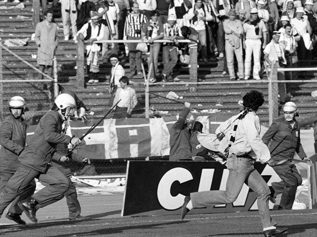 Belgium policemen run after Italian fans in Heysel stadium in Brussels on May 29, 1985