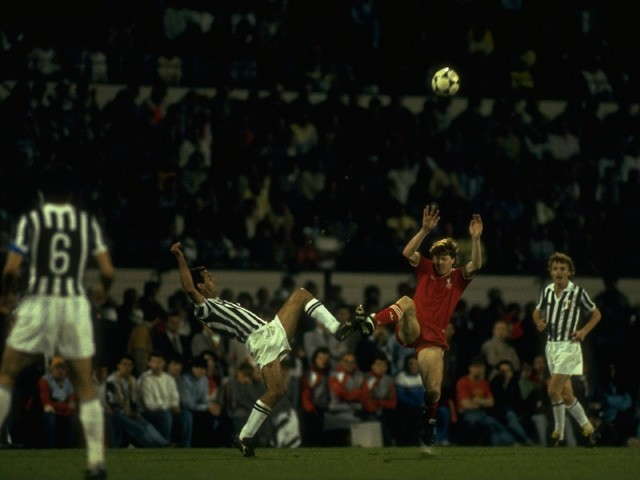 Cabrini of Juventus and Steve Nicol of Liverpool kick the ball together during the European Cup Final at the Heysel Stadium in Brussels on May 29, 1985