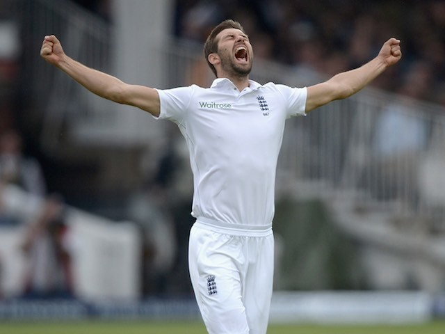 Mark Wood celebrates taking his first Test wicket for England during day three of the First Test against New Zealand on May 23, 2015