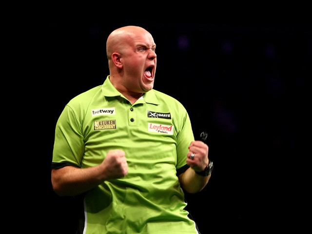 Michael van Gerwen of Holland celebrates winning his semi final match against Raymond van Barneveld of Holland during the Betway Premier League at The 02 Arena on May 21, 2015