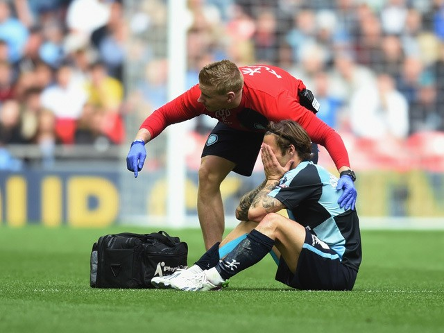 Sam Saunders of Wycombe is taken off injured during the Sky Bet League Two Playoff Final match between Southend United and Wycombe Wanderers at Wembley Stadium on May 23, 2015