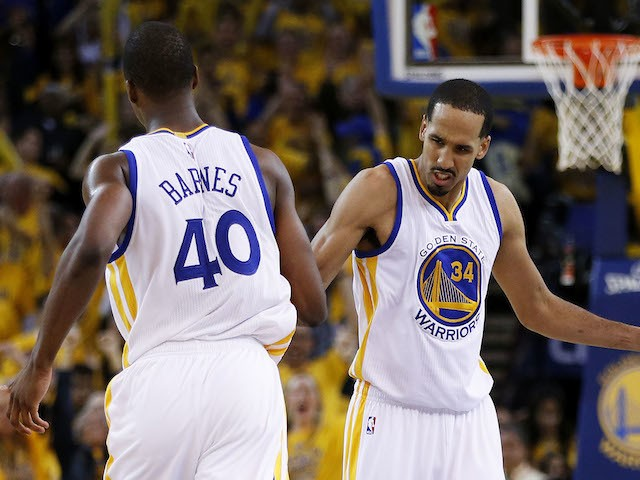 Harrison Barnes #40 and Shaun Livingston #34 of the Golden State Warriors celebrate in the fourth quarter against the Houston Rockets during Game One of the Western Conference Finals of the 2015 NBA Playoffs at ORACLE Arena on May 19, 2015