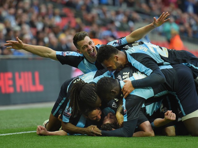 Ben Coker of Wycombe celebrates scoring a free kick to make it 1-0 with team mates during the Sky Bet League Two Playoff Final match between Southend United and Wycombe Wanderers at Wembley Stadium on May 23, 2015