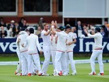 An assortment of England teammates celebrate as they take