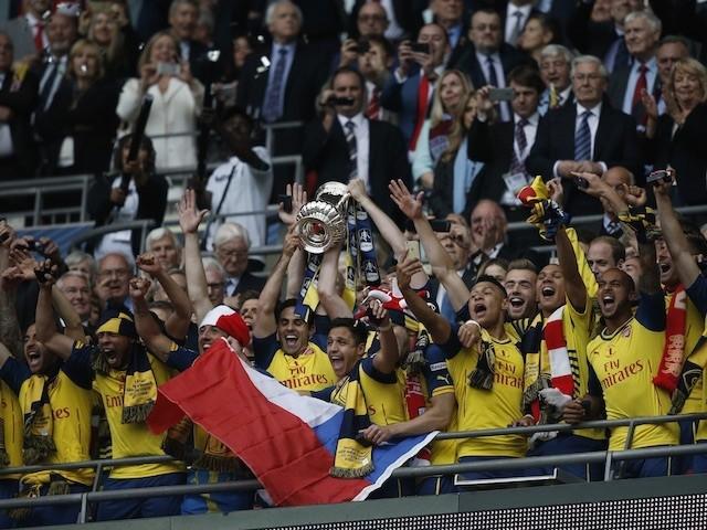 Arsenal lift the FA Cup trophy at Wembley after beating Aston Villa 4-0 on May 30, 2015