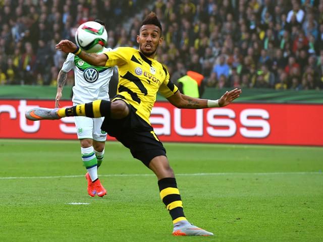 Dortmund's Gabonese striker Pierre-Emerick Aubameyang shoots to score during the German Cup DFB Pokal final football match between BVB Borussia Dortmund and VfL Wolfsburg at the Olympic Stadium in Berlin on May 30, 2015