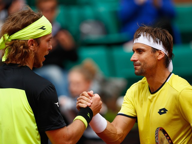 Lukas Lacko of Slovakia shakes hands with David Ferrer of Spain after Men's Singles match against on day three of the 2015 French Open at Roland Garros on May 26, 2015