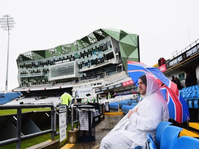 An England fan waits patiently in the rain on day one of the Second Test with New Zealand on May 29, 2015