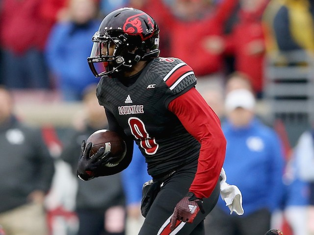 Gerod Holliman #8 of the Louisville Cardinals runs with the ball after intercepting a pass during the game against the Kentucky Wildcats at Papa John's Cardinal Stadium on November 29, 2014