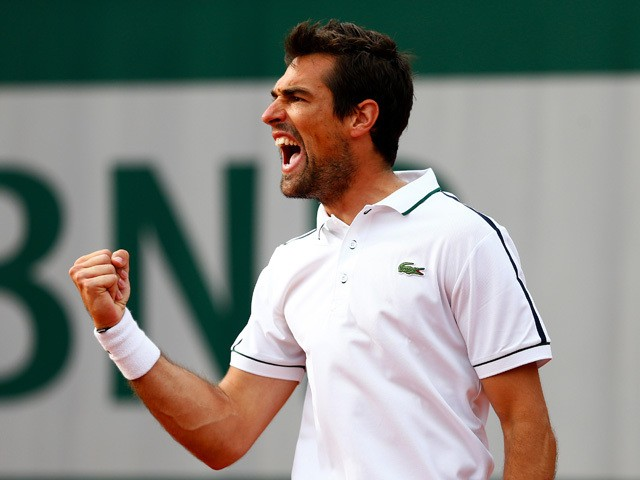 Jeremy Chardy of France celebrates match point in his Men's Singles match against John Isner of the United States on day five of the 2015 French Open at Roland Garros on May 28, 2015