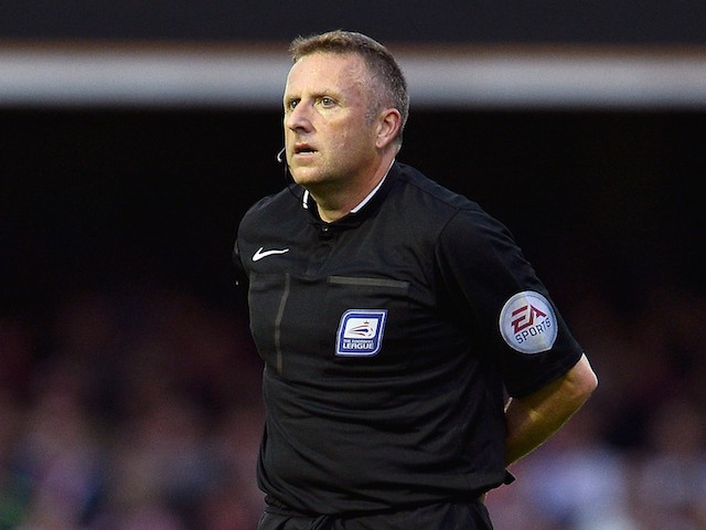Referee Jonathan Moss during the Sky Bet Championship Playoff Semi-Final at Griffin Park between Brentford and Middlesbrough on May 8, 2015