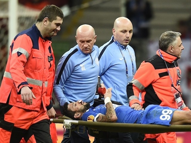 Dnipro's Brazilian forward Matheus (99) is carried off on a stretcher after being injured during the UEFA Europa League final football match between FC Dnipro Dnipropetrovsk and Sevilla FC at the Narodowy stadium in Warsaw, Poland on May 27, 2015