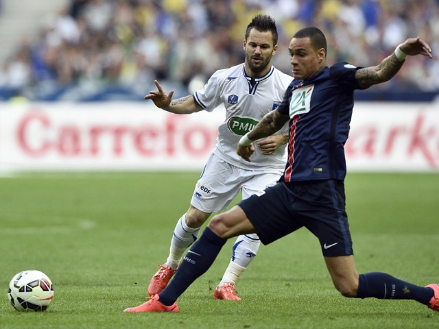 Auxerre's forward Frederic Sammaritano vies with Paris Saint-Germain's Dutch defender Gregory Van der Wiel during the French Cup final football match between Paris Saint-Germain and Auxerre on May 30, 2015