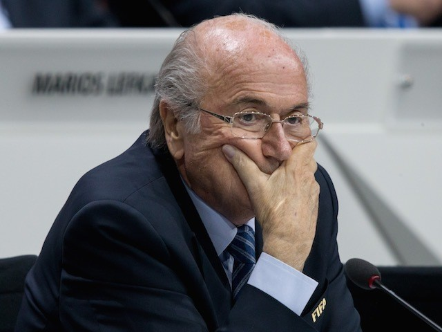 Sepp Blatter attacks his face with his own hands during the 65th FIFA Congress on May 29, 2015