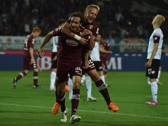 Emiliano Moretti of Torino FC celebrates his goal with team-mate Kamil Glik during the Serie A match between Torino FC and AC Cesena at Stadio Olimpico di Torino on May 31, 2015