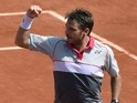 Switzerland's Stanislas Wawrinka reacts after winning the second set against Serbia's Novak Djokovic during their men's final match of the Roland Garros 2015 French Tennis Open in Paris on June 7, 2015