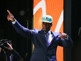 DeVante Parker of the Louisville Cardinals walks on stage after being picked #14 overall by the Miami Dolphins during the first round of the 2015 NFL Draft at the Auditorium Theatre of Roosevelt University on April 30, 2015