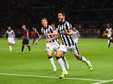 Alvaro Morata of Juventus celebrates scoring his team's first goal with Stephan Lichtsteiner during the UEFA Champions League Final between Juventus and FC Barcelona at Olympiastadion on June 6, 2015
