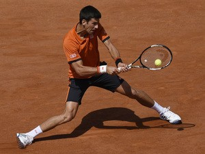 Serbia's Novak Djokovic returns the ball to Switzerland's Stanislas Wawrinka during their men's final match of the Roland Garros 2015 French Tennis Open in Paris on June 7, 2015